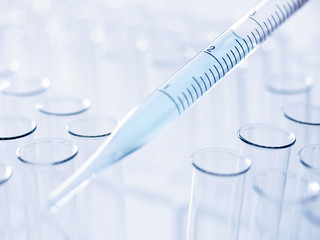 Close up of pipette and test tubes