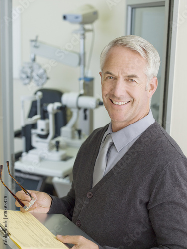 Ophthalmologist in examination room