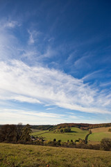 Cloudy blue sky above an English landscape in autumn