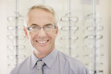 Optometrist standing in optometrist?s shop