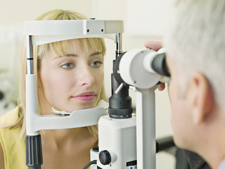 Eye doctor examining woman?s vision