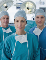Surgeons standing in operating room