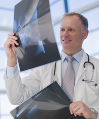 Doctor reviewing x-rays