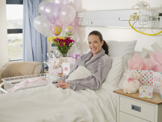 Woman recovering from birth in hospital