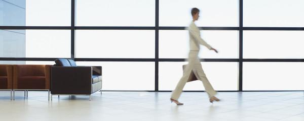 Businesswoman walking through office waiting area