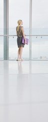 Businesswoman waiting in office lobby