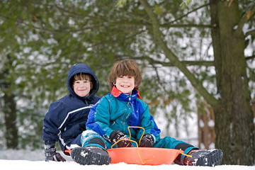 Boys Having Fun Sledding