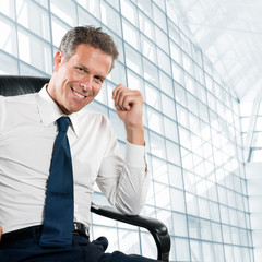 Smiling satisfied businessman