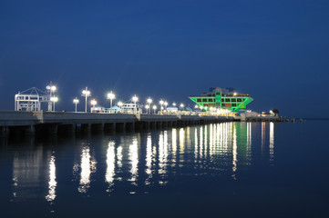 Pier in St. Petersburg illuminated at night. Florida USA