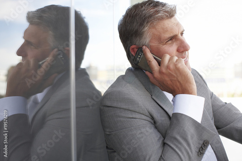 Senior businessman making a phone call