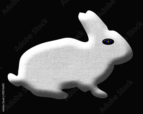 Easter or Sringtime background with a sculpture of white rabbit