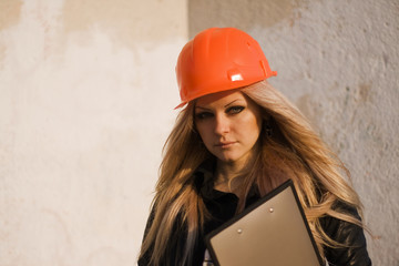 young girl in a helmet before building