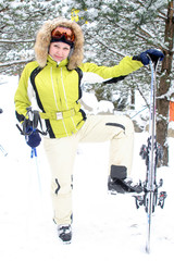 Beautiful girl skier, snowfall