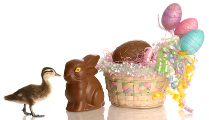 easter basket filled with eggs and chocolate bunny with duck