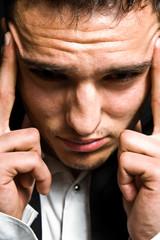 Stress concept - business man with headache