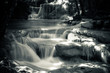 Multiple waterfall scene in black and white
