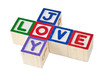 Wooden blocks forming the words love and joy isolated on white