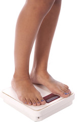 womans legs on scales