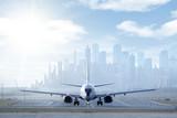 Big aircraft on runway in big city