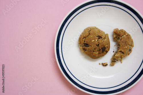 Bitten biscuit left in a plate,close up