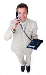 Confident young businessman talking on phone