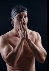 swimmer athlete facing the pool over black background