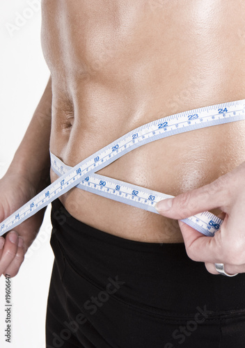 measuring tape around slim beautiful waist