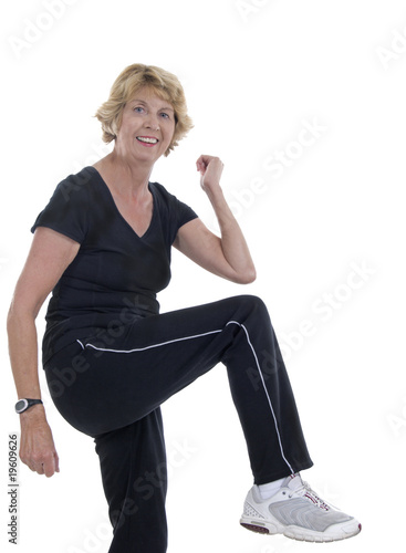 Elderly woman exercising to keep fit