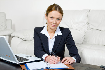 business woman with a laptop and diary