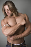 A bodybuilder measuring the increase in his bicep poster