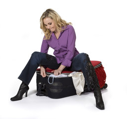 Woman Closing Her Suitcase