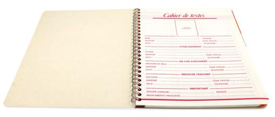 cahier textes ouvert fond blanc