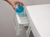 Adding detergent to dispenser poster