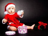 happy baby dressed as Santa
