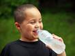 Smiling boy drinking
