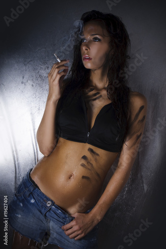 sexy wet brunette smoking cigarette