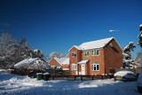 Detached house in snow with blue sky poster
