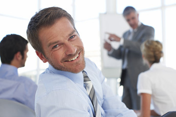 Happy businessman close up