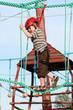 Child climbing in adventure playground