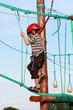 Child climbing in adventure playground