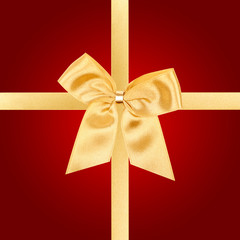 Gold Christmas bow on red card