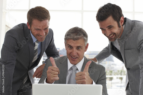 Mature businessman showing ok sign
