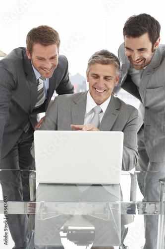 Businessmen with a laptop