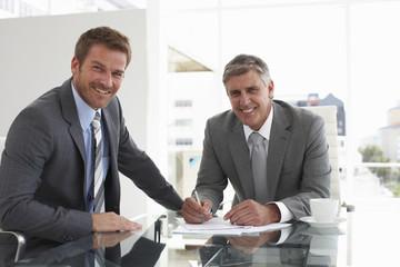 Two businessmen negotiating