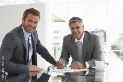 Two businessmen negotiating