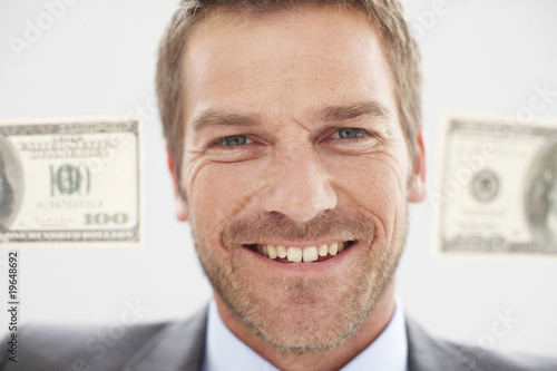 Happy man with dollar notes
