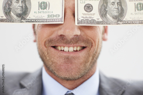 Man with dollar notes