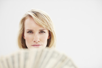 Attractive girl with banknotes