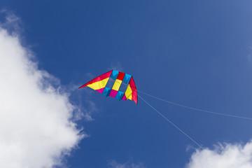 Kite on background of dark blue sky