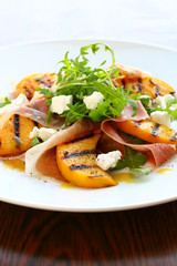 salad with grilled peach and ham